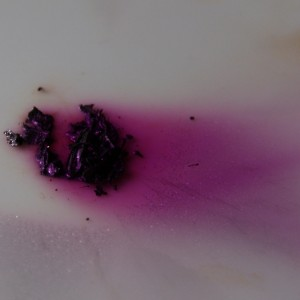 Iodine solid evaporating into the purple gas.